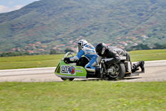 Lonely motorbike sidecar in the left turn on the track. royalty free stock photography