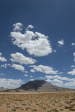 Lonely mount shadowed by clouds Stock Photo