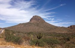 Lonely mountain. Mexico, Baja California, Rocks and blue sky, lonely mountain Royalty Free Stock Image