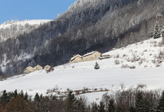 Lonely Mountain Village with snow-covered roofs Royalty Free Stock Image