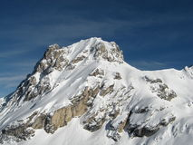 Lonely mountain in winter Alps Royalty Free Stock Images