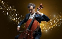 Lonely composer playing on cello royalty free stock photography