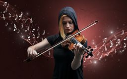 Lonely composer playing on violin stock photo