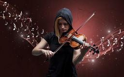 Lonely composer playing on violin stock photos