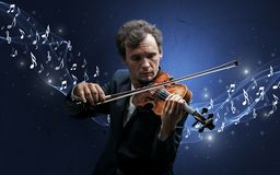 Lonely composer playing on violin stock photography