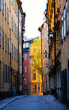 Lonely narrow alley in an old town Royalty Free Stock Photo