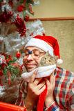 Lonely nerd celebrate christmas with his cat Stock Images