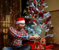 Lonely nerd celebrates Christmas talking on the Internet Stock Images