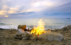 Lonely night fire on seacoast Stock Photo