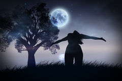 Lonely Night Landscape. Stylized silhouettes of a human with stretched arms and trees at night on the river Stock Images