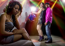 Lonely At Nightclub. Single black women jealous of interracial couple on dancefloor Stock Photos