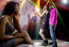 Lonely At Nightclub. Single black women jealous of interracial couple on dancefloor Royalty Free Stock Photography