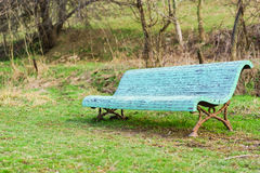 Lonely old blue bench in the spring Park Stock Photo
