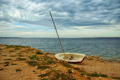 Lonely Old Boat On The Coast Royalty Free Stock Images