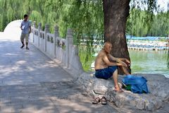The lonely old man enjoy cool air in the park Royalty Free Stock Images