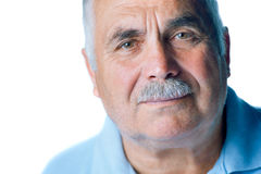 Lonely old man with gray hair and mustache Stock Photos