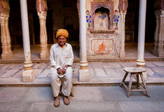 Lonely old man sitting inside an vintage indian house Stock Photography