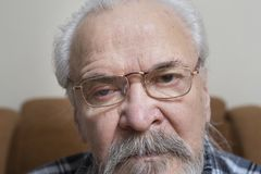 Lonely old man with sore eyes Royalty Free Stock Photo