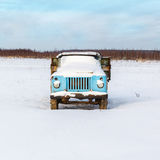 Lonely old rusty truck under the snow Royalty Free Stock Photos
