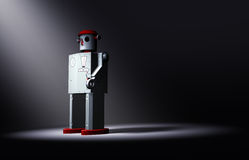 Lonely, Old Tin Toy Robot Faces The Light Royalty Free Stock Photos