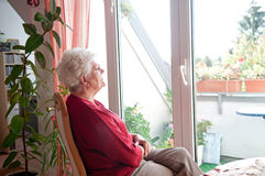 Lonely old woman Stock Photo