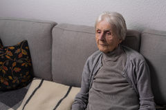 Lonely old woman Stock Image