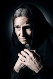 Lonely old woman in mourn and sorrow Royalty Free Stock Photos