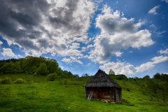Lonely old wood house on a mountain hill Stock Photos