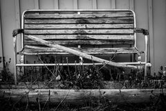 Lonely old wooden bench in the grass Royalty Free Stock Images