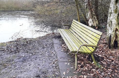 Lonely old wooden bench in a park Stock Photography