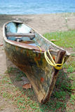 Lonely old wooden boat. Old wooden boat stranded on the beach Stock Photography