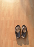 Lonely. One pair of shoes the soft evening sunlight feels lonely Stock Photography