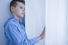 Lonely orphan with apathy. Waiting for a new family. Sad kid with depression Royalty Free Stock Images
