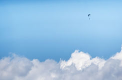 The lonely paraglider pilot above clouds. Royalty Free Stock Image