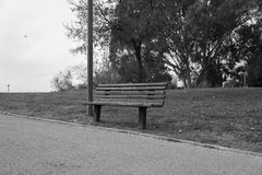 Lonely park bench Stock Photography
