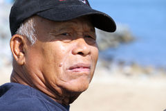 Lonely Past. Ungroomed senior Asian man looking back with sad expression Royalty Free Stock Image