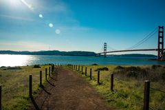 Lonely path with the golden gate bridge in the background in san francisco Stock Images