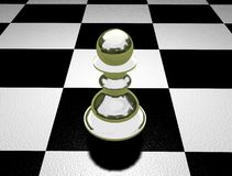 The lonely pawn. An image of a single chess pawn on a chess board, signifying loneliness Stock Photography