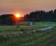 Lonely countryside road in sunset stock photography