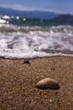 Lonely pebble on the beach against the blue sky Royalty Free Stock Photos