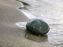 Free Lonely Pebble In Sand Stock Image - 58331511