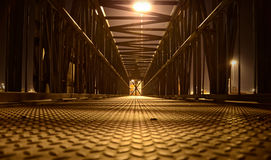 Lonely pedestrian bridge at night Stock Images