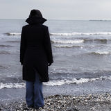 Lonely person on a beach. In winter time royalty free stock photo