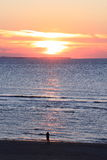 Lonely person looking at sunset, dutch Ameland Island Royalty Free Stock Photos