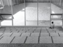 Lonely Person in a Modern Building royalty free stock image