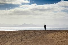 Lonely person at seashore Royalty Free Stock Photos
