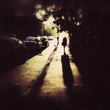 Lonely person silhouette. Silhouette  and shadow of a lonely person walking on alley. Image taken with a mobile phone camera
