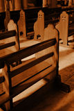 Lonely Pews Sepia. Empty Pews at a church in sepia tone Royalty Free Stock Photos