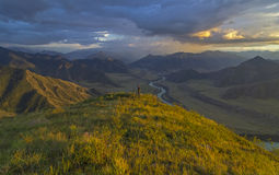 Lonely photographer on the mountain top. Katun River valley, Altai. Royalty Free Stock Images