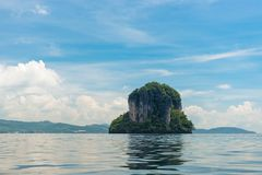 A lonely picturesque uninhabited island. A cliff in the sea of Thailand near the province of Krabi Stock Images